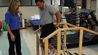 How to safely use stairs with your walker or crutches after joint replacement.